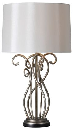 The Vesey lamp features a rich silver leaf finish, off-white shade and contrast black base.