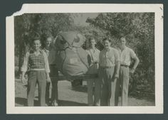 """Rice Institute owl mascot """"Sammy"""", a stuffed painted figure, posed with students S.J. Matthews, Bill Baird, Bill Rogde, Ed Franico and Cook, 1934"""
