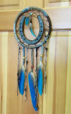 Unique 8 dreamcatcher- perfect to capture bad dreams and give you good luck! Hanging from this beauty is three 8 Blue and Gold Macaw feathers. The