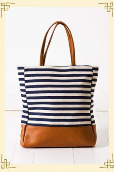 This bag is perfect for summer! The navy and white stripes give a nautical feel to it! love the brown straps and bottom!