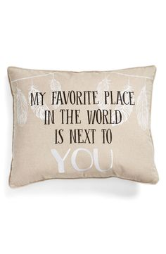 "Lending a touch of rustic charm to the home with this adorable pillow that includes a sweet sentiment, ""My favorite place in the world is next to you."""