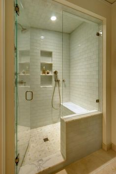 Tips for Making a Small Bathroom Look LargerThe shower is a great place to add more storage and give the illusion of greater space. Recessed shelving can be added in between the wall studs, or try adding a built in bench seating. Overhead lighting is also important, as the more light you have, the larger the shower will appear. Notice how the floor to ceiling glass shower doors help add reflective light as well.  I like the door opening in so that water doesn't drip on the floor.