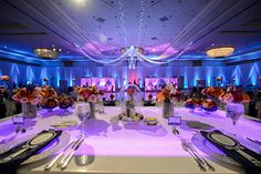 Walt Disney World wedding reception with Beauty and the Beast inspired rose dome centerpieces and sparkle details