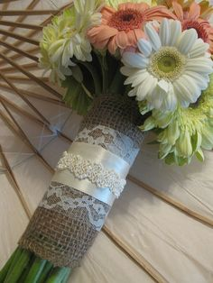 Burlap, lace, and ribbon bouquet wrap. Bringing in the elegance