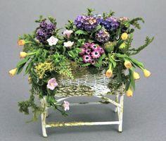 ...miniature floral display in wicker! --Laura Crain's Miniature Gardens Galore...