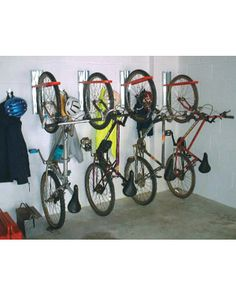Indoor vertical bicycle storage.This would be perfect for our new life, 2 road bikes 2 mountain bikes and gear O:-)