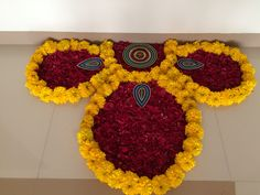 Design with flowers Rangoli Designs Flower, Rangoli Patterns, Rangoli Ideas, Rangoli Designs Diwali, Diwali Rangoli, Beautiful Rangoli Designs, Flower Designs, Rangoli With Flowers, Ganpati Decoration At Home