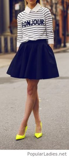 Blouse with shirt, black skirt and yellow shoes