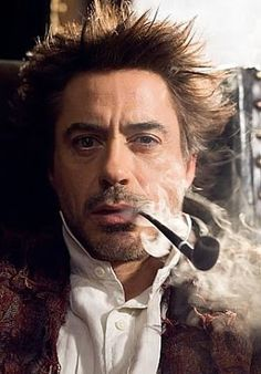 Robert Downey Jr as Holmes Robert Downey Jr., Sherlock Holmes Robert Downey, Sherlock Bbc, People Smoking, Man Smoking, Smoking Pipes, John Watson, Jude Law, Detective