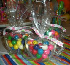 Party favor: gumballs in thrifted glass punch cup~LoVe doing this with jelly beans for easter. I like to find martini glasses and fill them with candy and wrap for party favors or a little something for holiday gifts