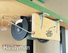 Small Workshop Storage Solutions. Flips all the way to the top of the bench when in use