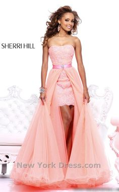 Shine bright in this decadent evening dress from Sherri Hill 21165. This body conscious and fitted style has a strapless neckline and is wrapped is glamorous lace.