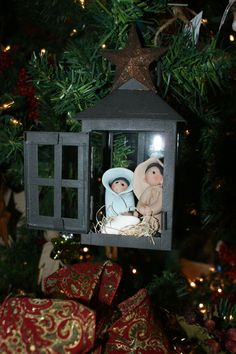 """A perfect Christmas Gift for those friends and family who collect nativities.  This is a hand made art piece.  Each figurine is hand sculpted.   The title of this piece is """"Jesus Christ the Light of the World.""""  The lantern helps symbolize this truth!"""