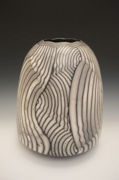 Large, hand-built and raku fired ceramics. David is instrumental in the development of naked raku pottery, inspiring ceramicists throughout the world.