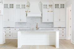This open concept kitchen features a very practical cabinet layout centered with a Salinas Granite countertop island.