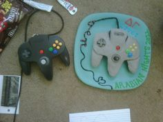 The N64 Controller Cake (RHS) I made for the AEPI & DG event. It's next to a real one
