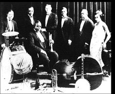 This is a picture of a jazz band from the 1920s. Jazz first became popular in the 1920s. There are a variety of instruments, from guitars to tambourines to saxophones to clarinets. Improvisation is used a lot in jazz music.