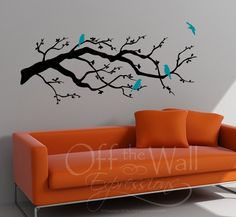 Contemporary Cherry Blossom Branch with Birds vinyl decal. $39.00, via Etsy.