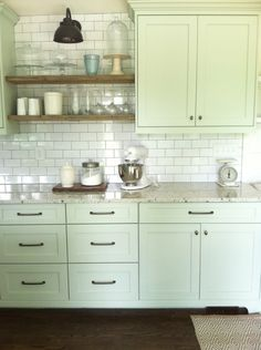 mint green cabinets| reclaimed wood shelves| hardware| lighting| subway tile