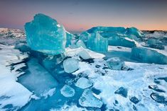 Ice Boulder Field - Jökulsárlón, Iceland _ This must be my favorite place and time to photograph. Jökulsárlón in winter is a magical place when conditions are right. A maze of frozen colorful ice sculptures which changes each time you are there. Here the blue light after sunset enhanced the deep blue color of the icebergs.