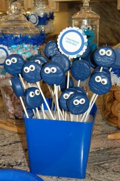 easy cookie pops- dye white chocolate baking chips dark blue and cover oreos. insert lollipop stick. put on some kind of white eyes (candy?) voila!