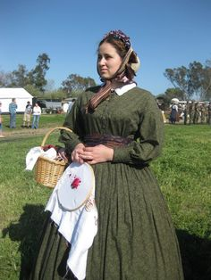 Here I am at the last reenactment I attended.  The old green work dress is still doing me proud!