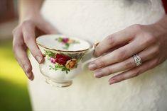 bride with tea cup (styled by www.frenchknotweddings.com / photo credit: www.izzyhudgins.com)