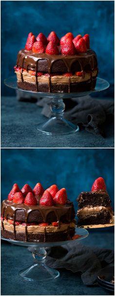 Strawberry Chocolate Cake Recipe on twopeasandtheirpod.com The BEST chocolate cake recipe! Chocolate cake with chocolate frosting, chocolate ganache, and sweet strawberries!