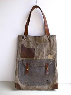 1960s era Canvas Tote Bag by Ranposki 1960s era Swedish military canvas has been reworked into a perfect everyday holdall tote bag with leather strap, pocket and bottom corner. Bag measures approximately 14.5 in (38cm) wide, 18.5 in (47cm) tall, 6 in (15cm) deep Strap drop approximately 10.5 in (27cm)
