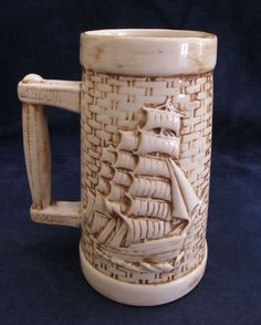 "Ceramic Sailing Ship Stein with a Basket Weave - This is a very nice nautically themed 7"" tall stein. This particular item is in very nice condition. The previous owner glued green felt to the bottom, and they didn't do a good job at that. I have not removed it as it is hidden when the stein is just being displayed.  This is a wonderful addition to a stein collection or to a nautically themed office or library."