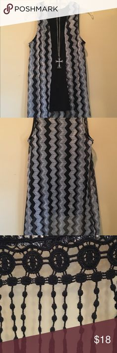 Long ,black and gray ,light weight vest Stylish long ,black and gray  chevron  vest , with cute fringe detail on the bottom !!! Looks great with leggings and boots !!! Tops Tunics