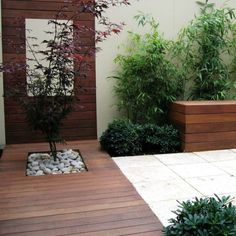 Cute Japanese Style Coutryard Garden with Brown Wooden Decks and Concrete Floor