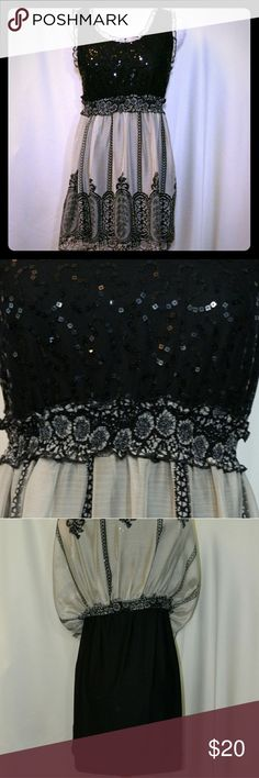 AMERICAN RAG Black & tan sequin dress Absolutely gorgeous dress! Flowy skirt with lace-like pattern, fully lined. Stretch upper top with sequin detail, with band that falls below the bust, ruffle detail around sleeves. Dress falls about mid-thigh/mini. 100% polyester. Size M. In excellent condition.                  Approximate Measurements: Toatl length from shoulder = 23 in; Armpit to armpit = 18 in; Skirt from waist = 19 in; 2 in straps. American Rag Dresses Midi