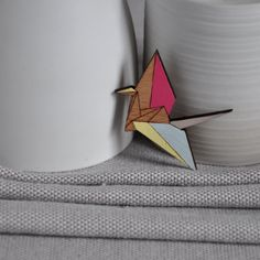 This Crane origami style brooch from ArtySmartyShop.com  is made from wood and then carefully hand painted in pastel colors and finished with a durable varnish. There are also matching necklaces, to go with these brooches.  #artysmarty #womenswear #fashionbloggers #accessories #nature #styleinspiration