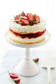 Strawberry Shortcake Cake   www.diethood.com   Layers of moist, buttery cake filled with strawberry pie filling and whipped cream frosting.   #recipes #cake #strawberries