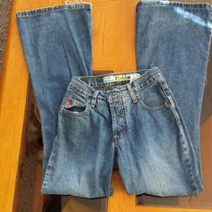 Mudd boot cut jeans Mudd boot cut jeans size 1, button fly and a little wear at the bottom. Mudd Jeans Boot Cut