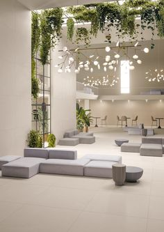 This open and light space is a great commercial design for a lobby so people can get to know one another. Clinic Interior Design, Lobby Interior, Salon Interior Design, Clinic Design, Cafe Interior, Retail Interior, Schönheitssalon Design, Lounge Design, Cafe Design