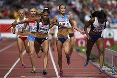 La Française Floria Guei franchit la ligne d'arrivée du relais 4x400m après avoir rattraper tout le monde! Le 17 août 2014 à Zurich et offre la médaille d'or aux filles du relais 4x400