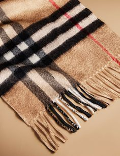 A lightweight cashmere scarf from the Burberry A/W13 accessories collection featuring the iconic check