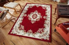 Striking Royal Red Rug with the beauty of traditional floral design. Simply Classic!! #royalrugs #luxuryrugs #largerugs #traditionalrugs #handtuftedrugs #woolrugs