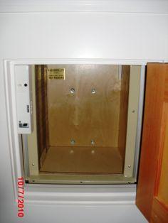 Exterior residential dumbwaiter showing beak gate closed for Exterior dumbwaiter