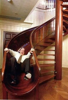 This is pure brilliance. I would LOVE to have a slide in my house. Love this dude's expression.