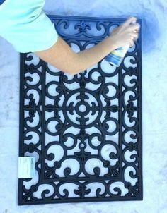 She sprays a rubber door mat blue and we LOVE this living room idea!