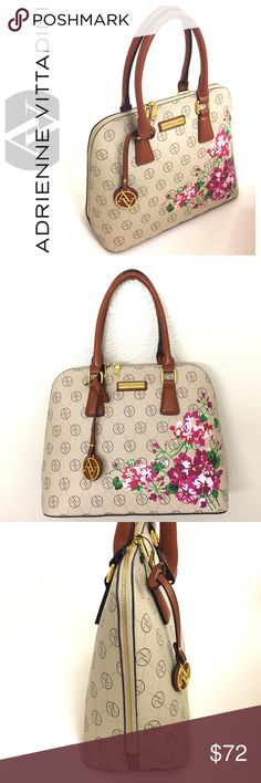 """🎉HP🎉Adrienne Vittadini Signature Satchel Brand new with tags. Such a girly, fun look! This Adrienne Vittadini Signature Collection Dome Satchel in cream with floral print on the front of the bag is a spring must have! This bag is crafted from high quality faux leather with gold tone accents. Features top zip closure; is fully lined; has 2 slip and 1 zip interior accessory pockets. Measures 13""""W X 11""""H X 6""""D with a 7"""" handle drop. Reasonable offers will be accepted😊 Adrienne Vittadini Bags…"""