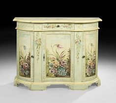 "Floral-Decorated Oxbow Cabinet, 20th century, on bracket feet, h. 34-1/2"", w. 41"", d. 13-1/4""."
