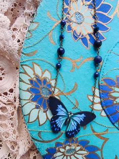 Wooden Butterfly, Gemstone and Glass Beads with bronze color metal chain. Length 45cm