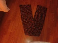 'new earth tone crocheted scarf' is going up for auction at  1pm Wed, Mar 6 with a starting bid of $12.