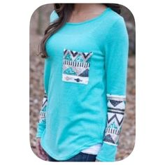 """2xHP 10/26 & 10/16! LAST ONE!! NWT Aztec T-Shirt 2xHost Pick 10/16/15 &  10/16/15! """"Best in tops party""""! """"Steals and Splurges Posh Party""""!Super cute fall top in absolutely brilliant colors! Perfect for a nice fall day! This top is a little shorter than the picture shows and runs a size smaller! Go one size up! Please use the offer button ! Chosen by @happystore please check out her amazing closet!  Boutique Tops Tees - Long Sleeve"""
