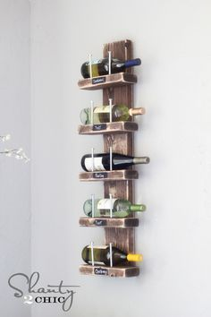 DIY Wood and Hex Bolt Wall Wine Rack. Really cute! You can put a little piece of chalkboard right under the shelves so you can change the labels!