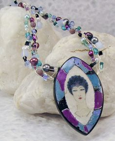 This is lovely.  I love the colors, and the peals, beads that match....